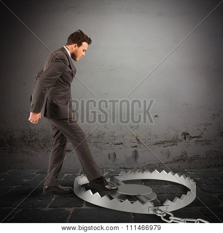Man puts his leg in a trap stock photo