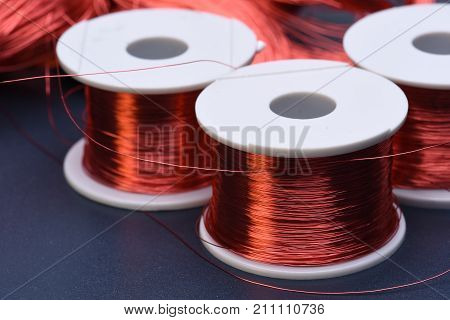 Copper electric coil and wire on metal background stock photo