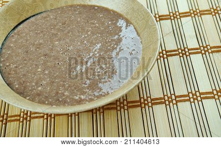 talkan porridge - coarse flour from fried barley or wheat cuisine of Khakass Altai Bashkirs Buryats Kazakhs Kirghiz Mongols Tatars Uzbeks Chuvashes stock photo