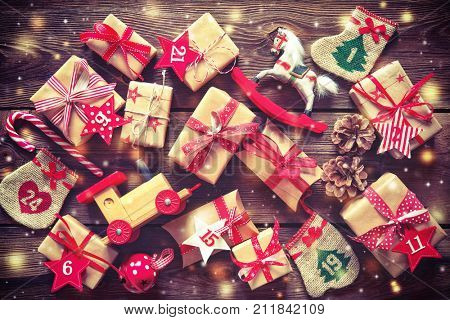 Christmas background. Wrapped with ribbon gift boxes, toys and others presents with the numbers as A