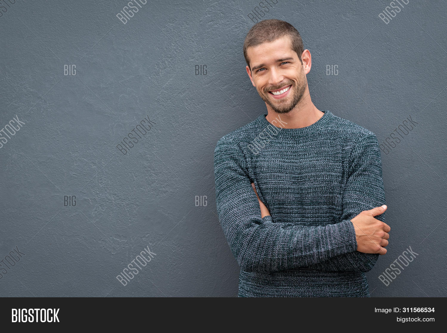 arm,autumn,background,casual,casual man,cheerful,confident,cool,cool guy,copy space,crossed,crossed arms,expression,fashion,fashionable,friendly,gray wall,grey,grey background,guy,handsome,handsome man,happiness,happy,isolated,leaning,looking,looking at camera,people,portrait,positive,proud,reliability,satisfied,smile,standing,studio,stylish,success,successful,sweater,sweater man,toothy smile,wall,winter,winter clothes,young,young man