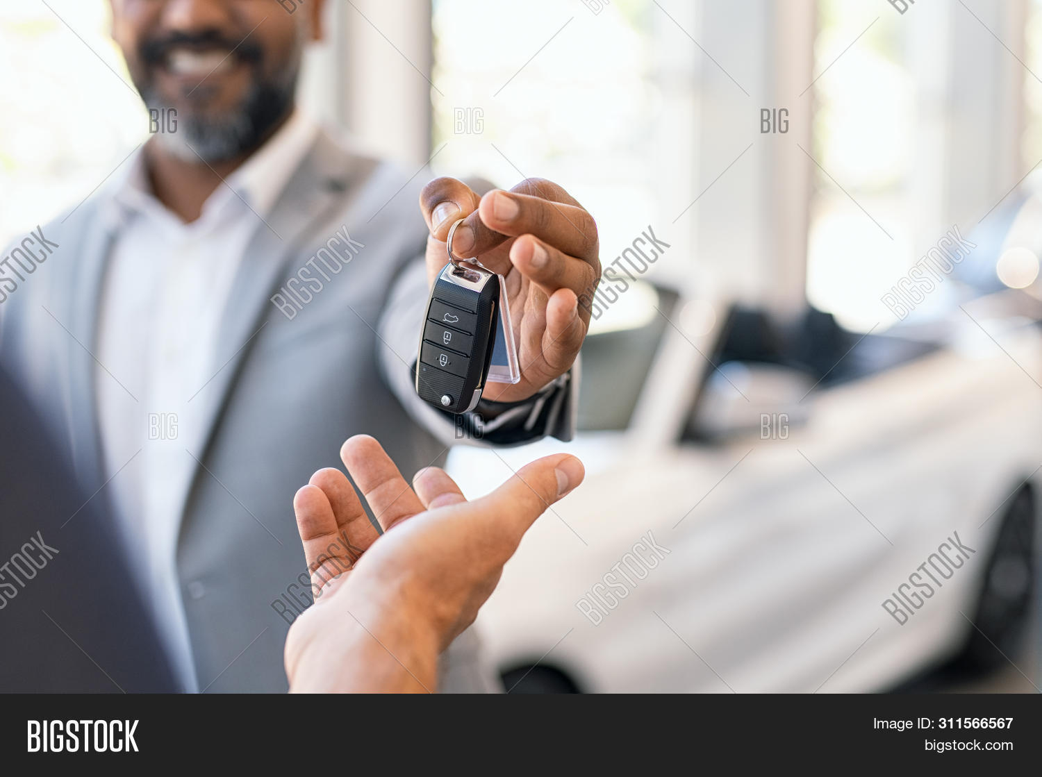 african,african business,agent,agreement,american,auto,auto care,automobile,automotive,buy,buyer,car shop,client,close up hands,closeup,copy space,customer,deal,dealer,dealership,detail,giving,giving car keys,hand,holding,insurance,key,luxury,man,multi ethnic group,new,owner,people,purchase,rental,sales,salesman,salon,sell,seller,service,shopping car,showroom,showroom car,transport,transportation,vehicle