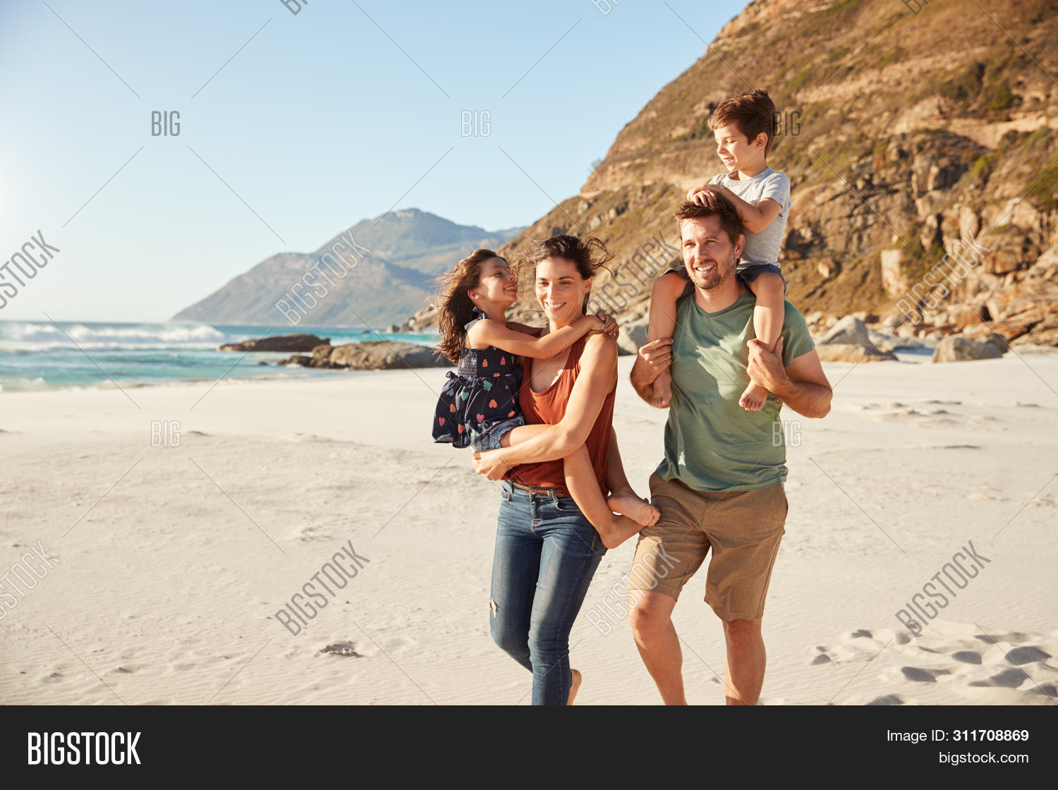 30s,adults,adventure,beach,bonding,boy,carrying child,caucasian,children,confident,copy space,daughter,day,exploring,family,father,four people,free time,freedom,fun,getting away from it all,girl,happy,holiday,horizontal,husband,journey,kids,leisure activity,man,millennial,mother,outdoors,parents,pre-teens,seaside,sitting on shoulders,smiling,son,sunlight,the great outdoors,three quarter length,togetherness,travel,vacation,walking,wife,woman,young adults