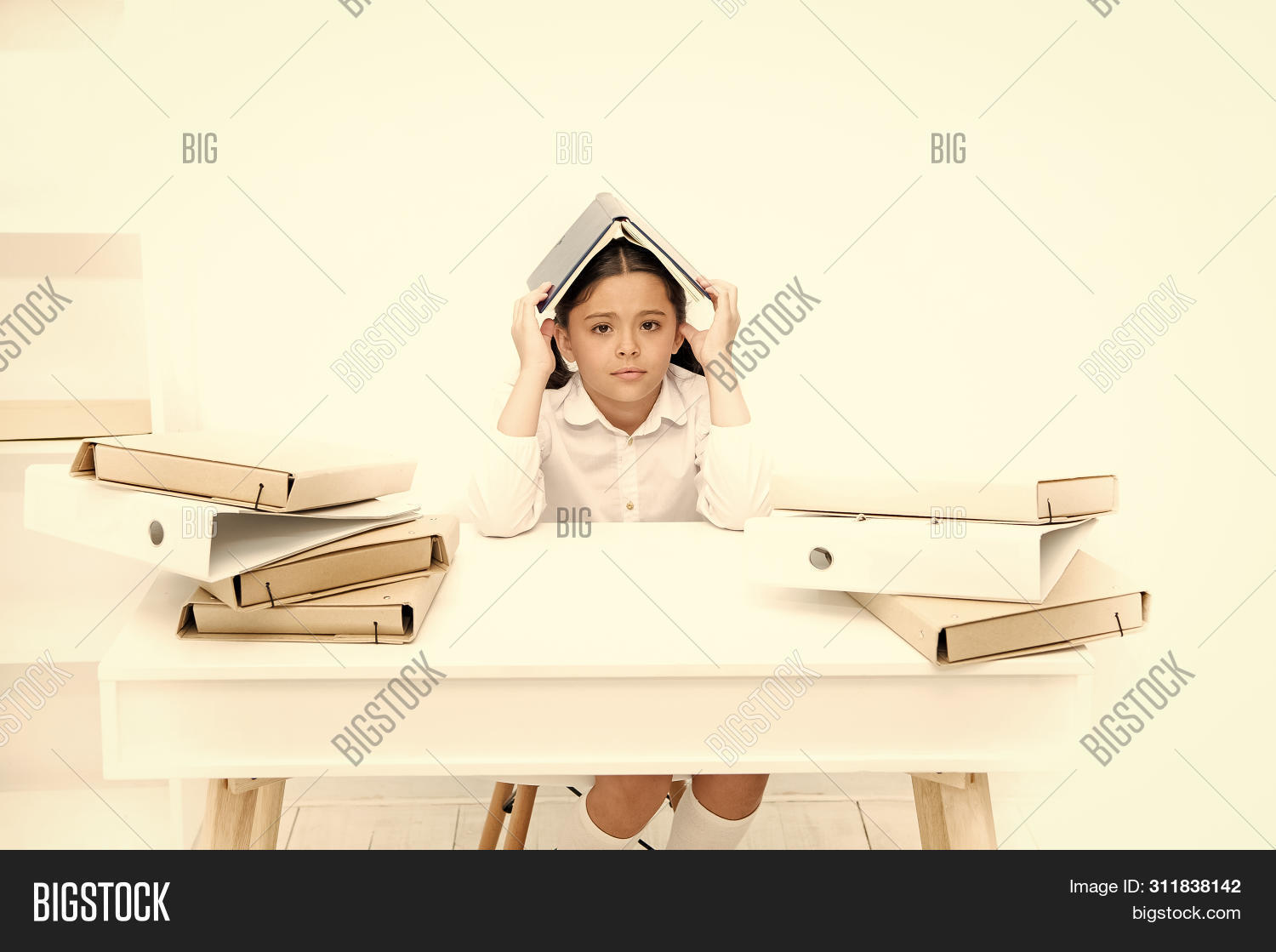 Back to school concept. Kid cute tired of studying. Boring lesson. Boring task homework. Get rid of boring task. Girl bored pupil sit at desk with folders and books. Issues of formal education.