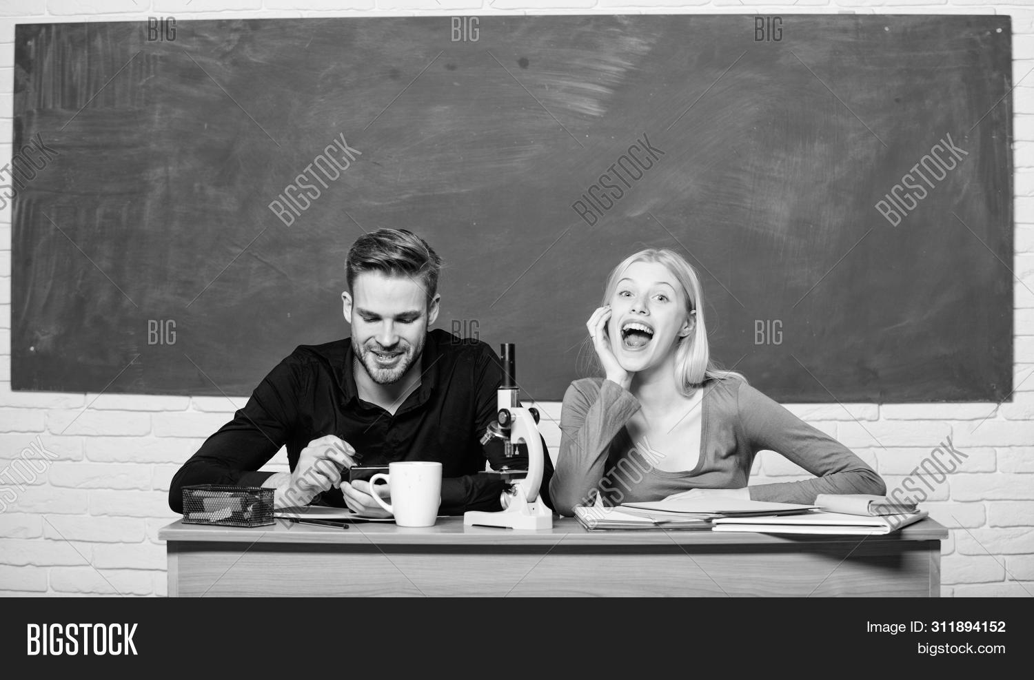 Scientific Experiment. Guy And Girl At Desk With Microscope. Studying In College Or University. Biol