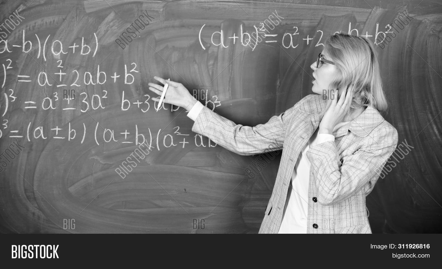 Teacher On School Lesson. Woman In Classroom. Study And Education. Modern School. Knowledge Day. Bac