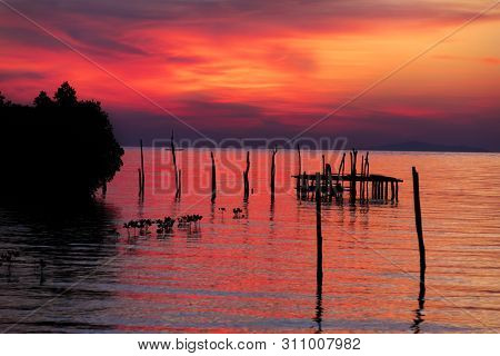 A beautiful sunset over the water at Raja Ampat stock photo
