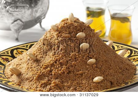 Traditional Moroccan almond sellou made from roasted flower, almonds,herbs and honey stock photo