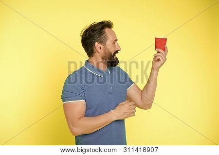 Relaxing coffee break. Drink it on the go. Man bearded prefer coffee take away. Eco lifestyle and recycling. Recyclable coffee cup. Hipster mature man hold paper coffee cup stand yellow background. stock photo