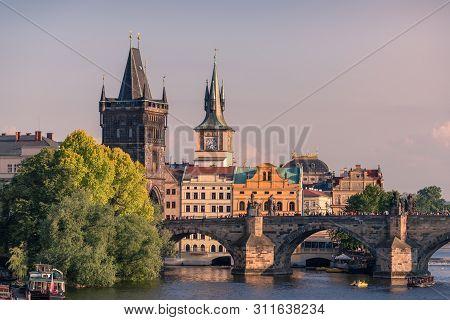 Prague landmarks of Bridge Tower and Charles bridge at golden hour. Czech Republic, Prague stock photo