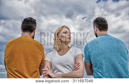Best traits of great boyfriend. Girl thinking whom she going ask dating. Everything you need to know about choosing right guy. Girl stand in front two faceless men. She needs to pick better boyfriend stock photo