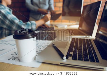 Working In The Morning With Businessmen Are Dipping Coffee That Works With Software Developers To An