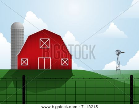 Barn, silo and windmill on an open, rolling plain stock photo