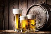 Two glasses and mug of light lager