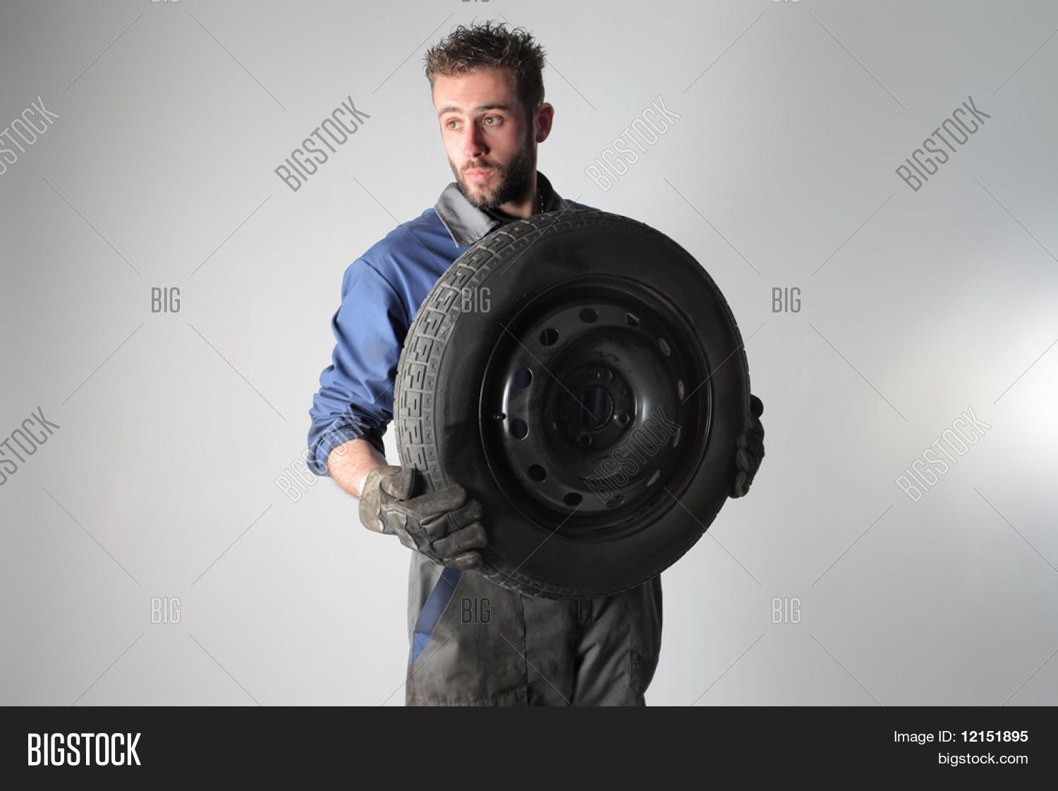 adjusting,auto,automotive,boy,car,change,check,device,dirty,engine,equipment,fix,fixing,garage,guy,help,instrument,isolated,maintain,maintenance,male,man,manual,mechanic,mechanical,new,occupation,old,part,portrait,professional,repair,restore,rim,road,service,spare,substitution,technician,tool,transmission,transportation,tread,tyre,vehicle,wheel,white,work,worker,workshop