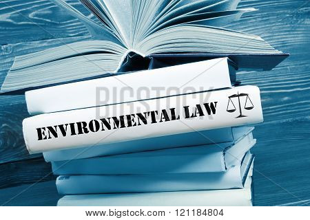 Law concept - Law book with Environmental Law word on table in a courtroom or law enforcement office. Toned image. stock photo