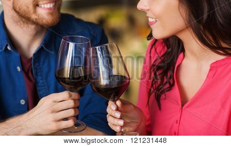 leisure, celebration, food and drinks, people and holidays concept - smiling couple having dinner an