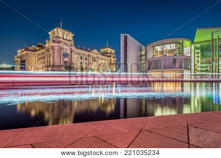 Panoramic view of Berlin government district with famous Reichstag building, seat of the German Parliament (Deutscher Bundestag), and Paul Lobe Haus in twilight during blue hour at dusk, Berlin, Germany stock photo