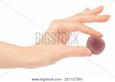 Fruit jelly in sugar in hand on a white background isolation stock photo