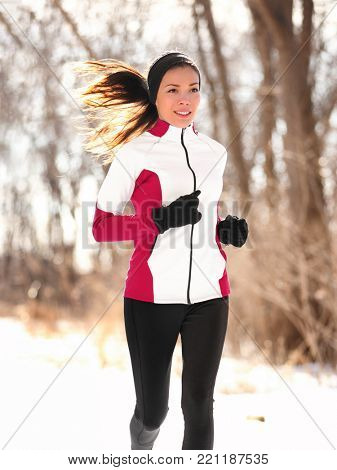 aa1fbd207922 🔥 Winter runner woman jogging outside in forest. Jogger fit Asian girl  running outdoor breathing cold