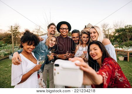 Group Of Multiethnic Friends Drinking And Socialising