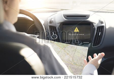 GPS navigation system. Person driving a car with satellite navigation. stock photo