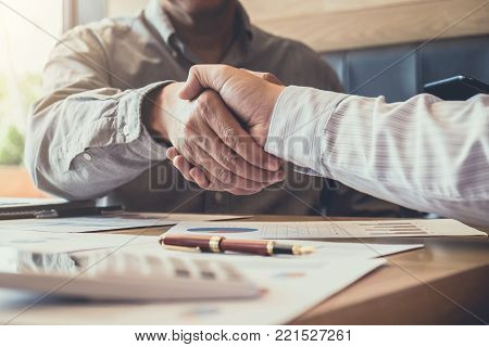 Greeting new colleagues team, business people shaking hands during a meeting to sign agreement and become a business partner, Successful businessman handshake after good deal for both companies.