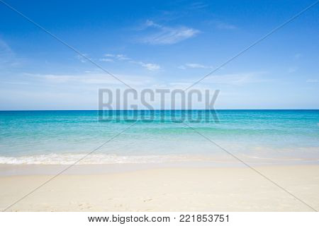 Sea view from tropical beach with sunny sky. Summer paradise beach of Phuket island. Tropical shore. Tropical sea in Puhket.Exotic summer beach with clouds on horizon.Ocean beach relax, outdoor travel