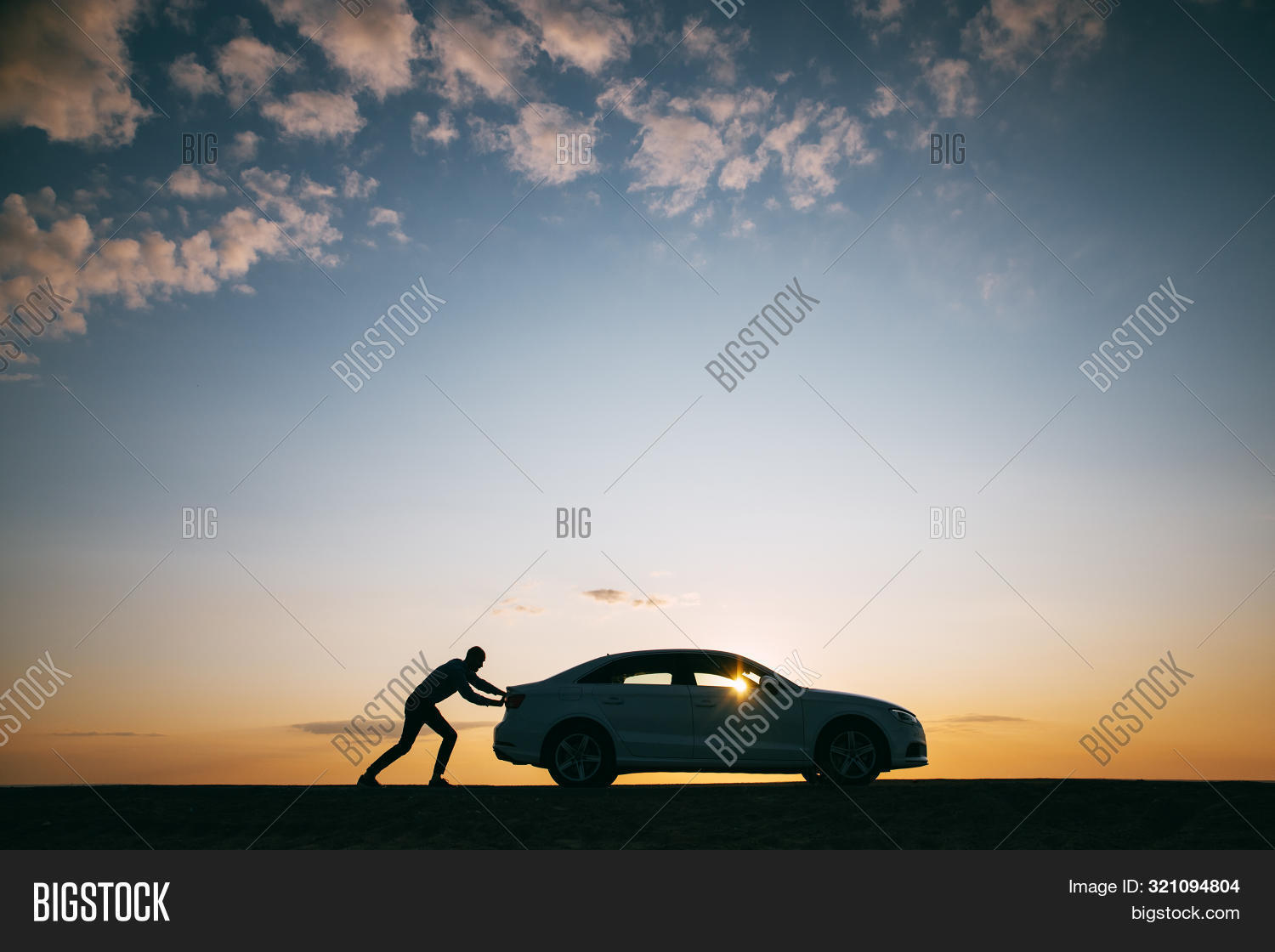 adventure,auto,automobile,break-down,breakdown,broken,car,countryside,despair,driver,dusk,effort,engine,frustration,fuel,help,landscape,male,man,out,petrol,problem,push,road,sky,sun,sunset,towing,transportation,trouble,vehicle,vehicular