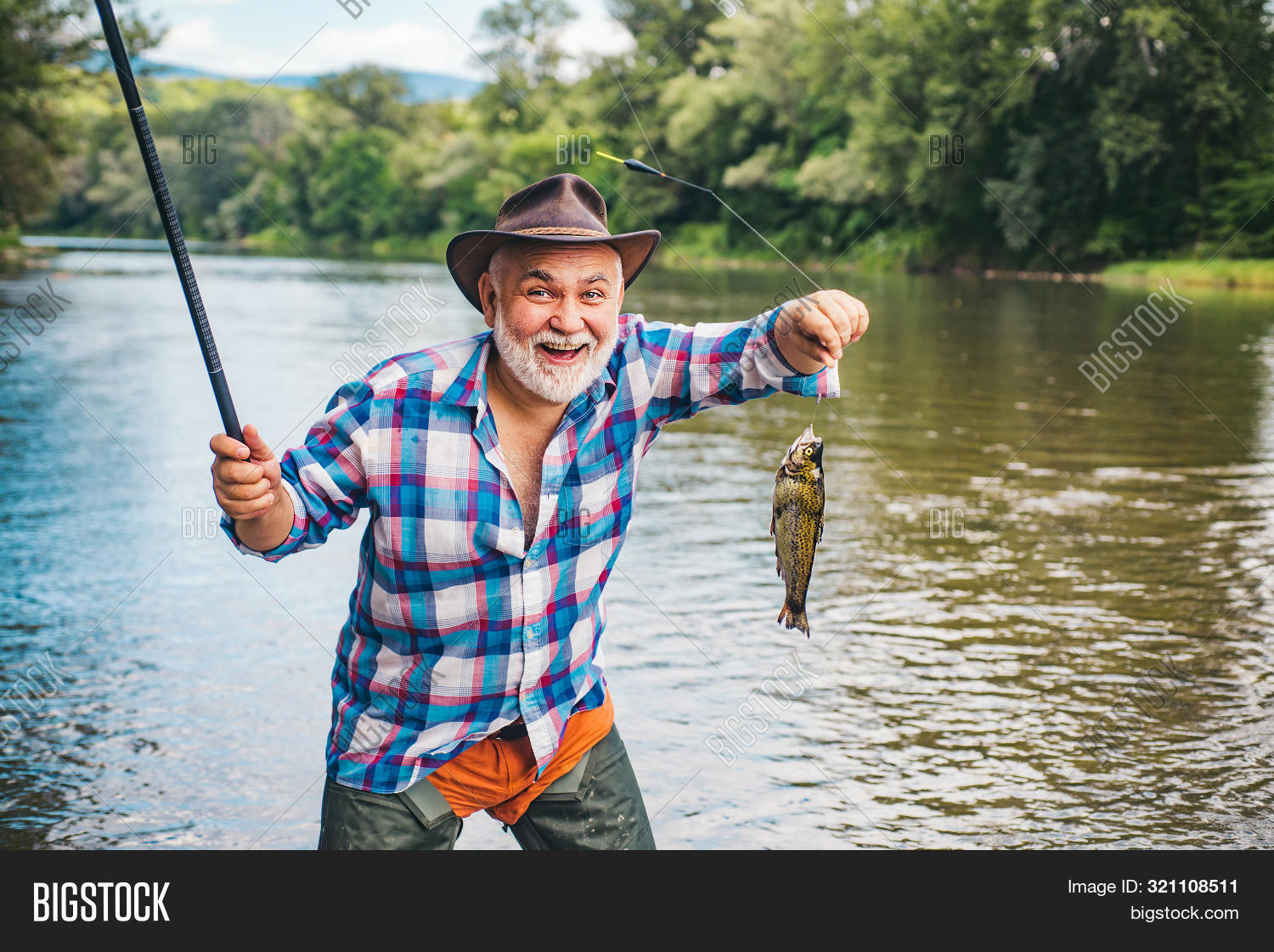 activity,american,angler,angling,background,beard,bearded,catch,catching,equipment,fish,fish-rod,fisher,fisherman,fishermen,fishery,fishhook,fishing,fishman,float,fly,flyfishing,freshwater,handsome,hobby,leisure,male,man,men,nature,net,outdoor,person,pull,recreation,river,rod,season,shiny,spinning,splash,sport,stream,success,tackle,trout,vacation,weekend,wild,wildlife