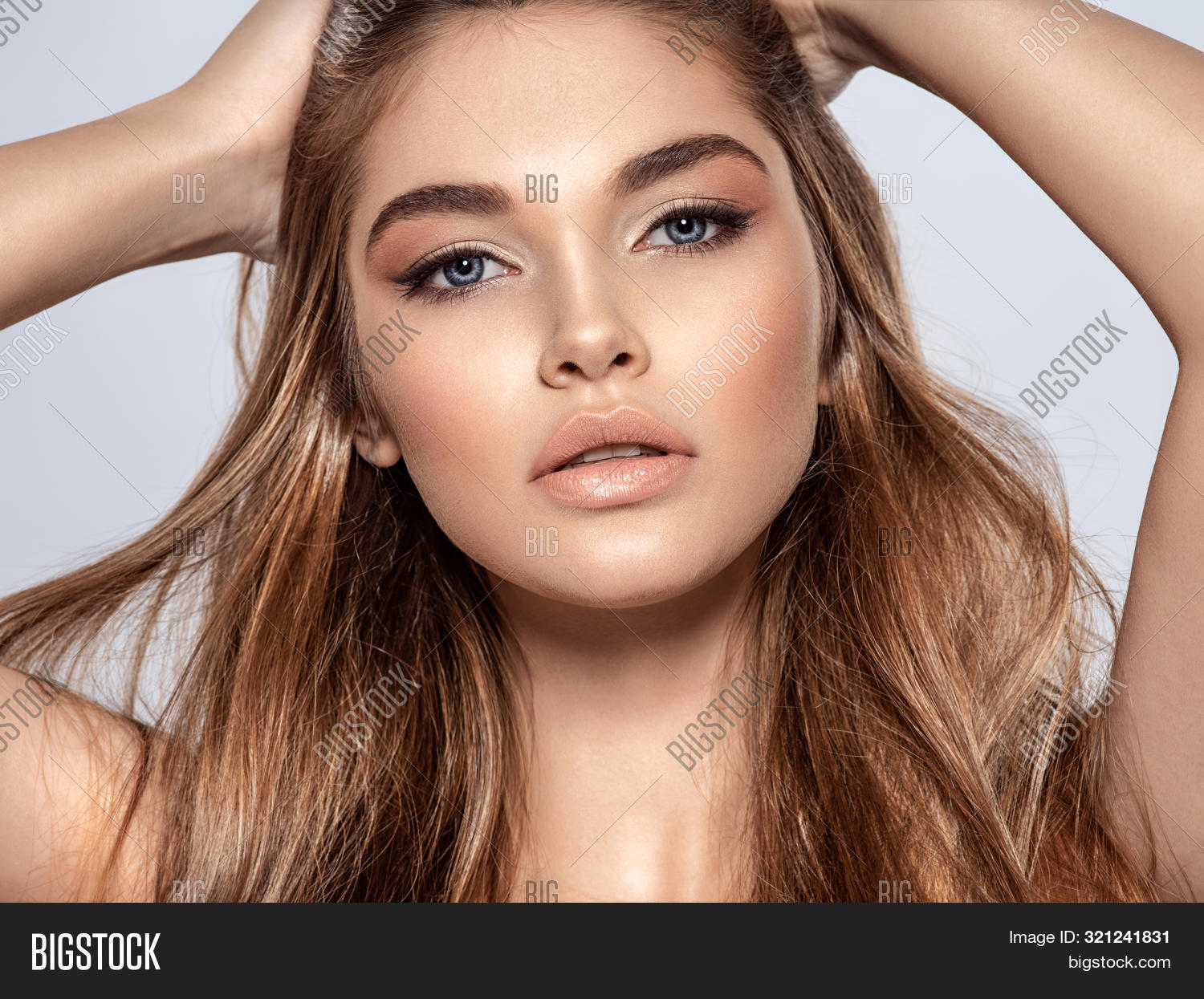 Woman with beauty long brown hair and natural makeup.  Beautiful face of an attractive  model with b