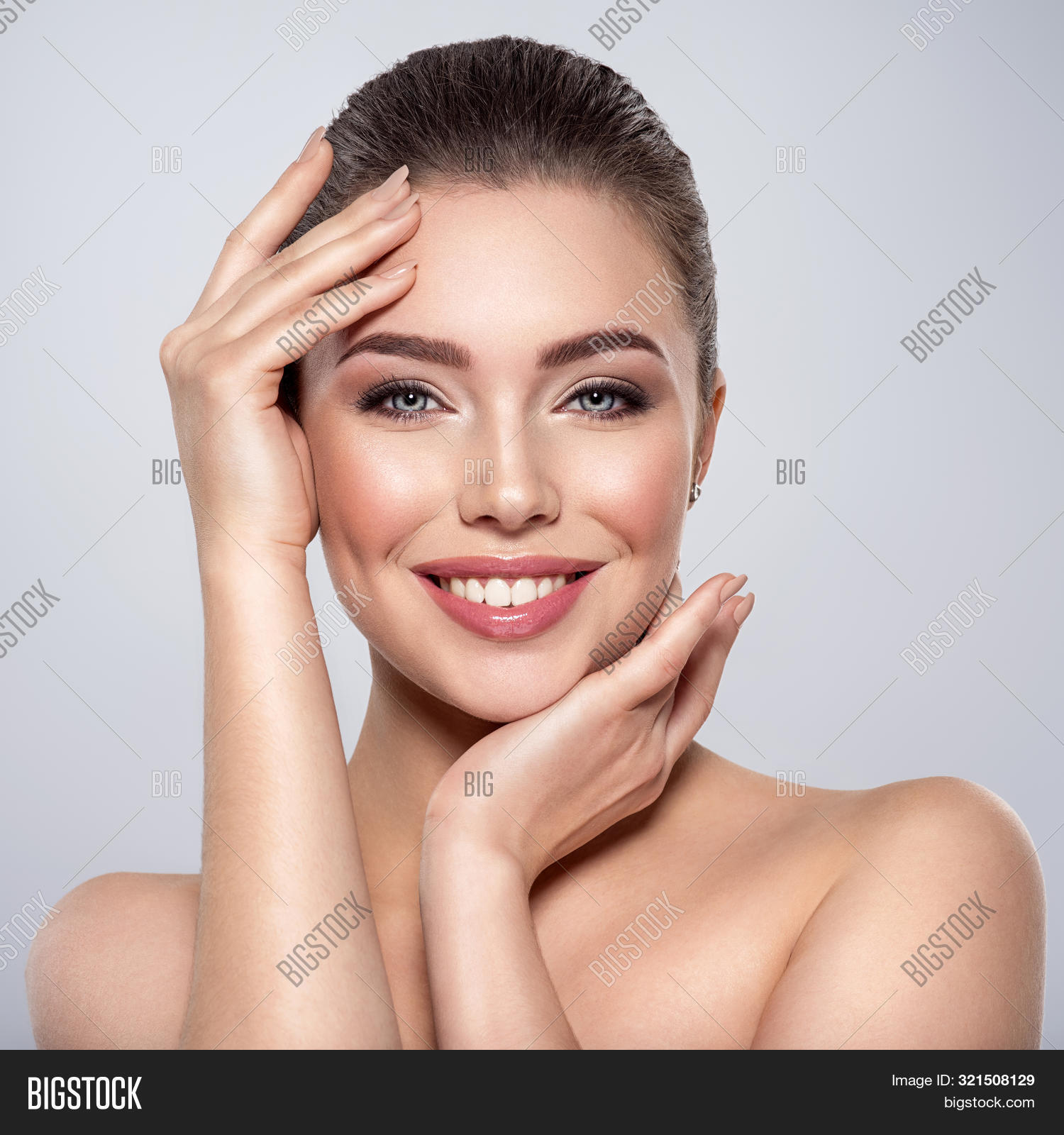 adult,attractive,beautiful,beauty,blue eyes,brunette,care,caucasian,cheerful,clean,face,female,fresh,girl,hand,hands,happy,health,isolated,one,pamper,pampering,portrait,pose,posing,pretty,skin,skin care,smile,smiling,smokey,smokey eyes,smokey makeup,studio,touch,white,white background,woman,young