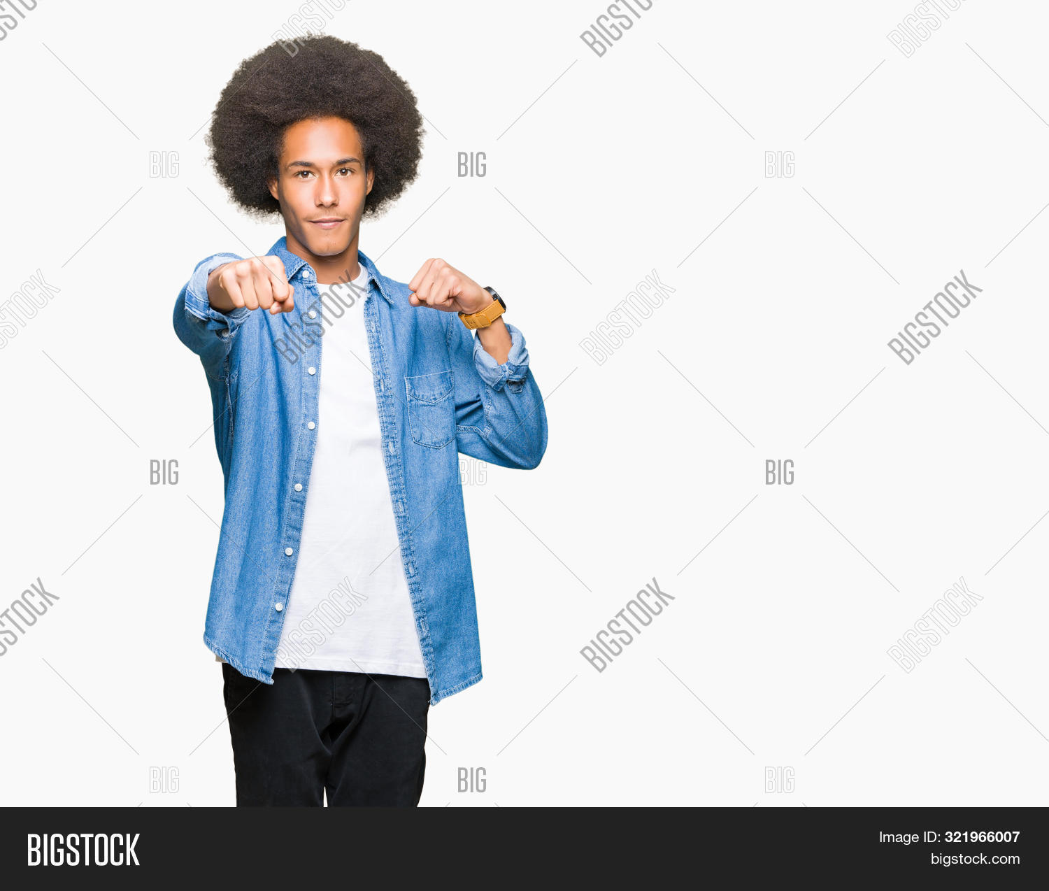 adult,african,afro,aggression,aggressive,american,anger,angry,arm,assault,attack,background,boxing,brazilian,casual,clenched,conflict,cool,cuban,denim,expression,fight,fist,force,gesture,hair,hairstyle,hand,handsome,hit,isolated,jacket,latin,man,negative,person,portrait,power,punch,sign,strength,strike,strong,symbol,teenager,threat,tough,victory,violence,young