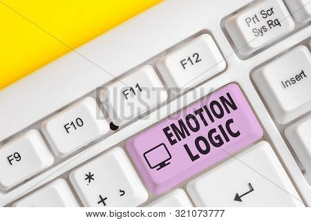 Writing note showing Emotion Logic. Business photo showcasing Heart or Brain Soul or Intelligence Confusion Equal Balance White pc keyboard with note paper above the white background. stock photo