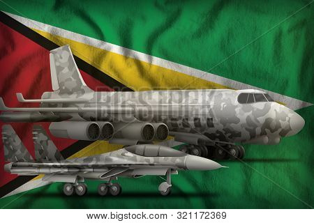 air forces with grey camouflage on the Guyana flag background. Guyana air forces concept. 3d Illustration stock photo