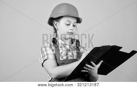 Builder engineer architect. Future profession. Kid builder girl. Build your future yourself. Initiative child girl hard hat builder worker. Child care development. Safety expert. Foreman planning stock photo