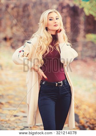 Autumn hair care is important so as to avoid dry frizzy hair. Long hair care concept. Cold blonde concept. How repair bleached hair fast and safely. Girl fashionable blonde walk in autumn park stock photo