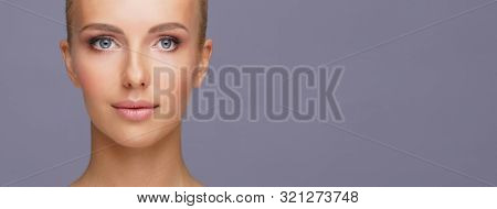 Attractive face of beautiful girl. Close-up portrait of healthy woman. Skin care, cosmetics, makeup, complexion and face lifting. stock photo