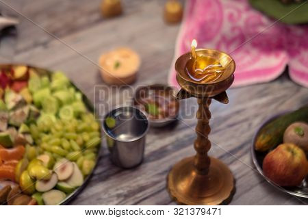 Diya oil lamp lit during durga puja or diwali. Background image for puja essentials on this festive season with space for text. stock photo