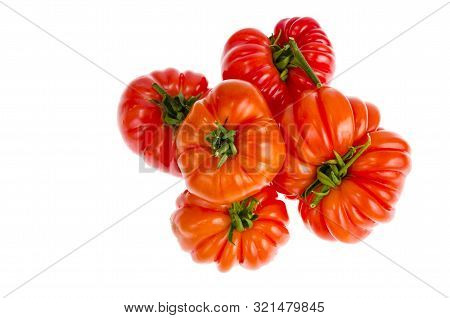 Red fresh beefsteak tomatoes on white background. stock photo