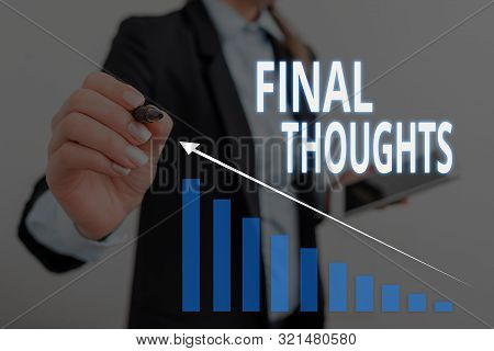 Text sign showing Final Thoughts. Conceptual photo the conclusion or last few sentences within your conclusion Woman wear formal work suit presenting presentation using smart device. stock photo