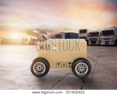 Priority Cardboard box with racing wheels like a car. Fast shipping by road. stock photo