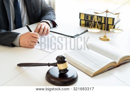 The private office workplace for consultant an young lawyer legislation with gavel and document on wood table, legal justice and judgment concept stock photo