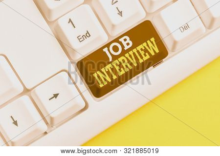 Word writing text Job Interview. Business concept for Assessment Questions Answers Hiring Employment Panel White pc keyboard with empty note paper above white background key copy space. stock photo