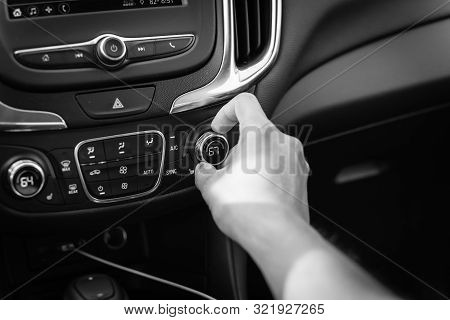 Filtered tone Asian right male hand turning knob button temp adjust air conditioner to 67 F degree stock photo