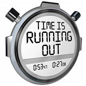 A stopwatch or clock with the words Time is Running Out to caution you that the clock is ticking and