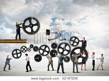 Conceptual image of businessteam working cohesively. Interaction and unity stock photo