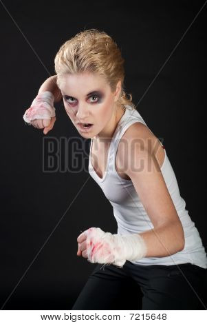 white girl fighter with blond hair on black background stock photo