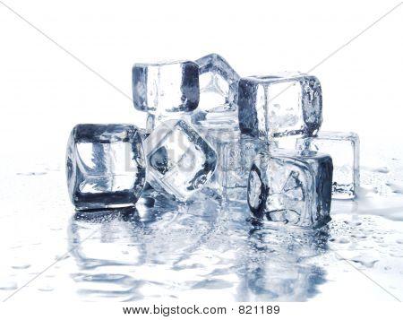 Melting ice cubes on white bacground stock photo