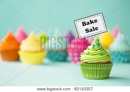Cupcake with Bake Sale sign stock photo